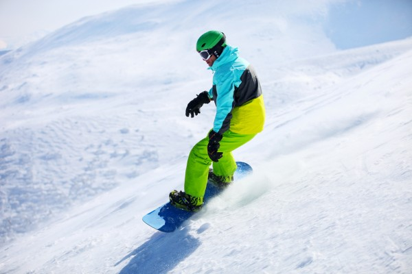 Snowboarder sliding down a slope