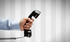A hand holding telephone
