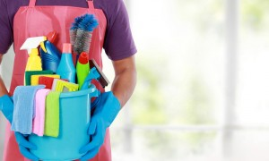 maid holds bucket of cleaning products