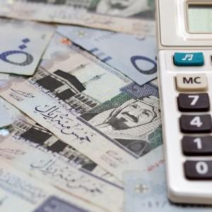 calculator on top of Saudi Arabia money