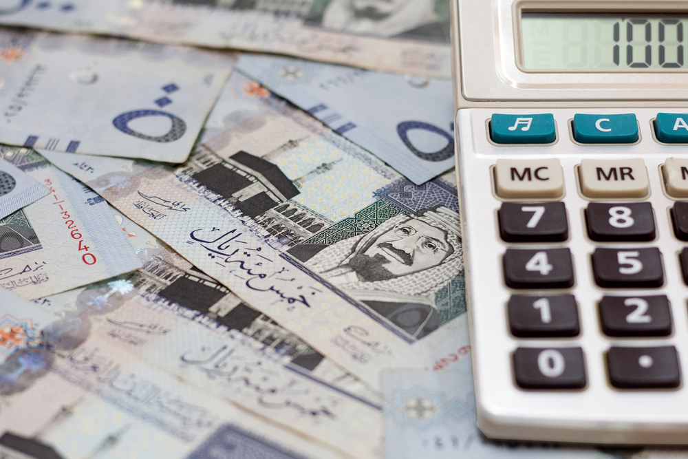 calculator on top of Saudi Arabia money