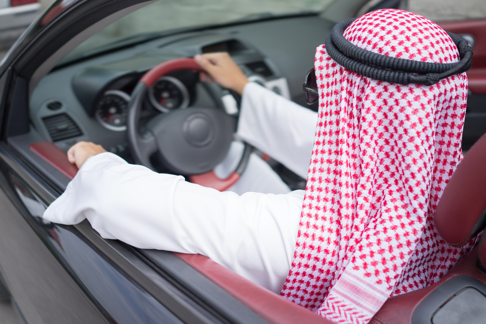 Arab man driving car