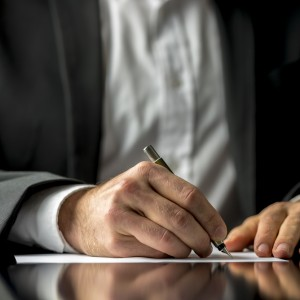 a man writting on a paper
