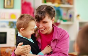 Special needs education (SEN) teacher and child at school