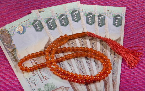 UAE dirhams (currency) and prayer beads