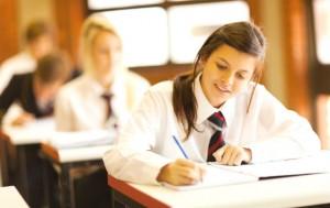 School girl writes in book