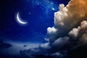 Crescent moon and cloudy sky