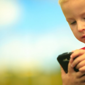 A boy using a mobile phone