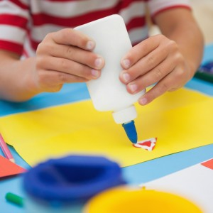Child plays with coloring paper at nursery