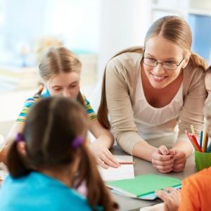 Schoolkids and their teacher talking