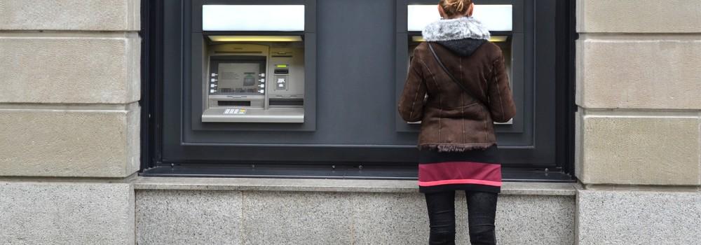 Woman at an ATM machine