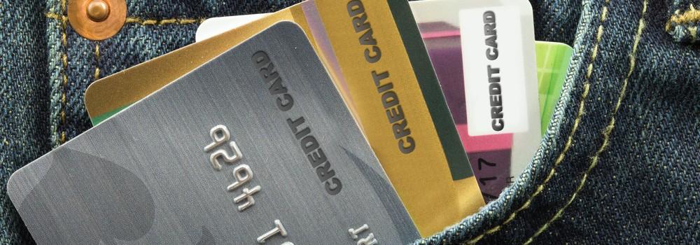 credit cards in blue jeans pocket