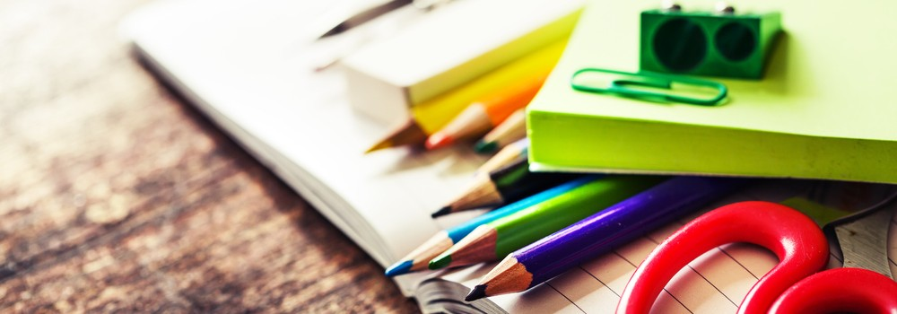 Stationery in school book on desk
