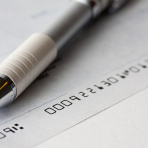 A cheque with a pen