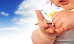 Baby and coin