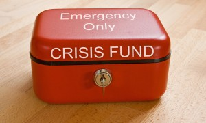 Closed red cash tin marked Crisis Fund