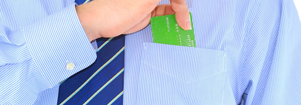 Businessman with credit card in shirt pocket