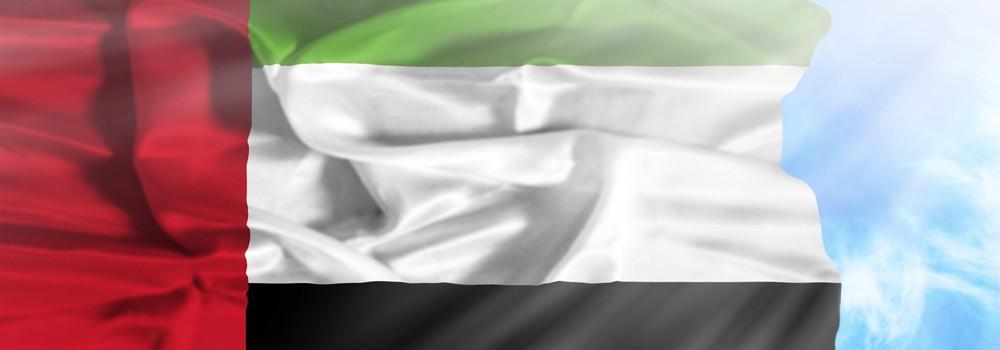 UAE national flag in sky