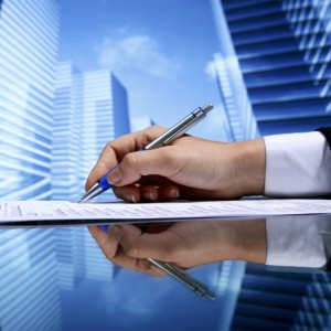 signing contract on skyscrapers background