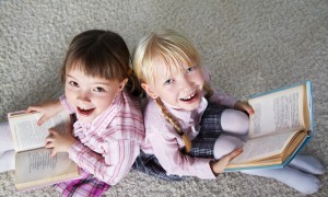 Two schoolchild with books in hand