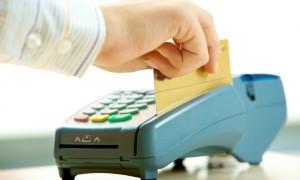 A person using a credit card in a payment machine