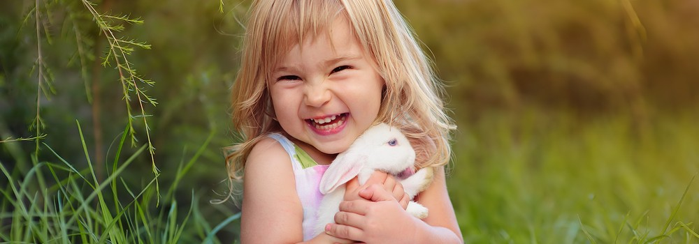 A girl with a bunny rabbit