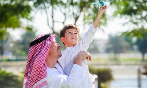 Arabic father and little kid play outdoors
