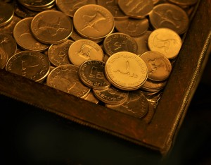 UAE coins in a wooden box