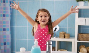 Little girl smiling in the bathroom