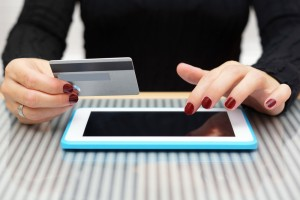 Woman is using credit card for on line shopping