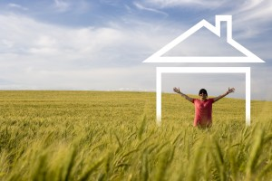Happy person in the middle of the field enjoying new house