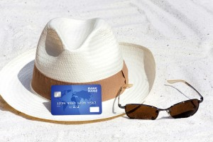 card and hat on beach