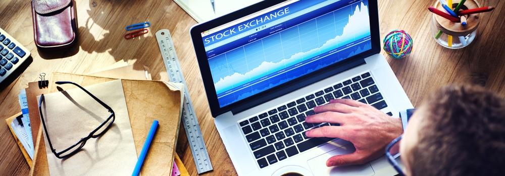 Man Analysis Stock Exchange on Computer