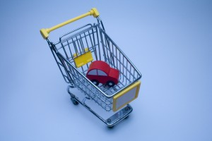 a shopping basket with a car