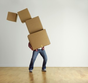 Man carrying stacked boxes on moving day