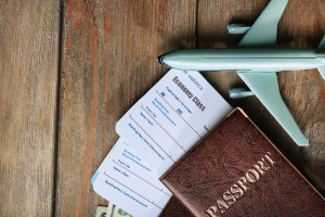 Airline tickets and documents on wooden table