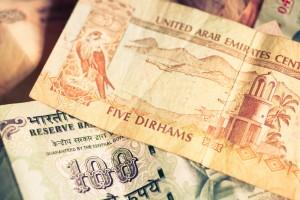 Focus on currencies of United Arab Emirates and Republic of India