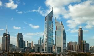 Skyscrapers in skyline of Dubai against blue sky