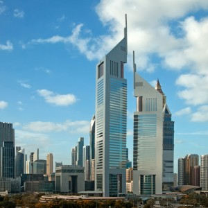 Skyscrapers in skyline of Dubai against blue sky