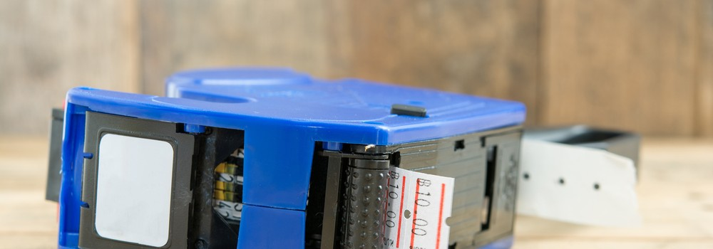Blue plastic price label machine