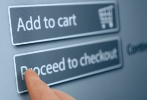 Online Shopping - Finger Pushing Add To Cart Button On Touchscreen