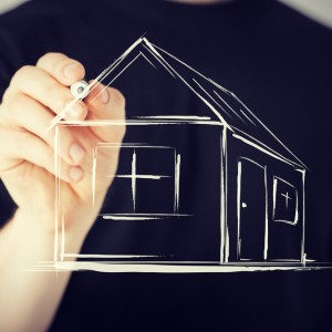 Picture of man drawing a house on virtual screen