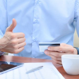 Successful businessman with a credit card in hand