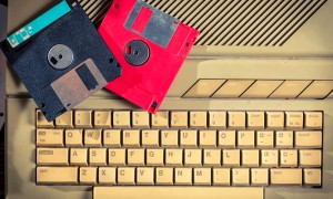 Vintage floppy disks and keyboard