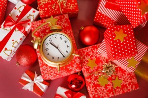 Christmas big red gift box with red alarm clock