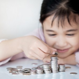 Little girl and pile coin for saving. money saving concept