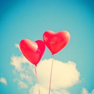 Retro love balloons on blue sky