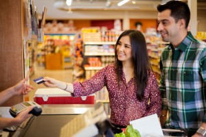 buying some groceries at the supermarket and paying with a credit card