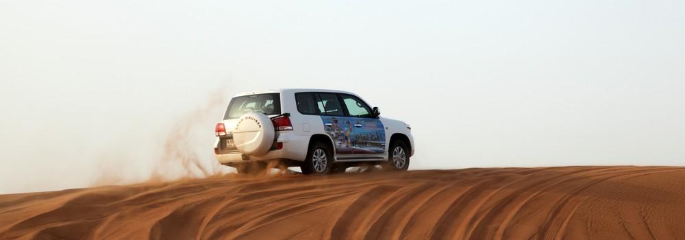 A 4x4 on a sand dune