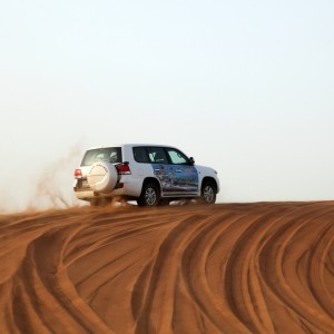 A 4x4 on a sand dune